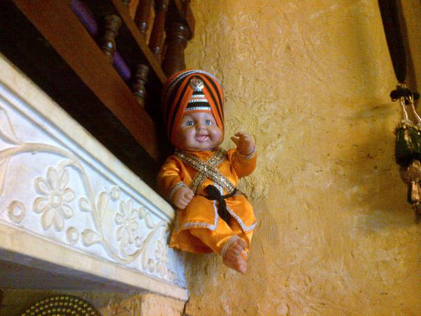 127 - The Sikh doll