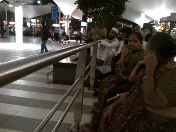 126 - Indian family waiting at the airport