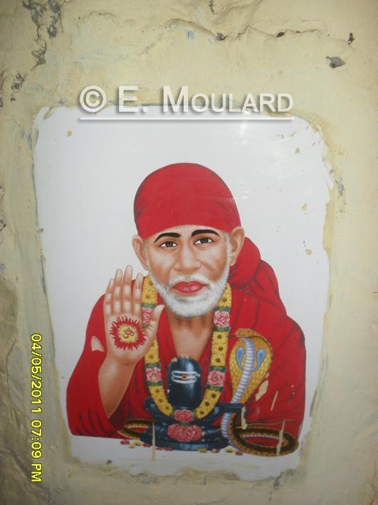 Idols on the walls - Sai Baba